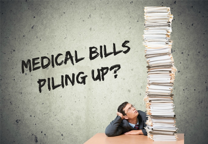 What can I do if my workers' comp case was denied and my medical bills are piling up?